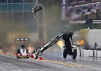 Mar 14, 2015; Gainesville, FL, USA; NHRA top fuel dragster driver Larry Dixon (right) crashes alongside Doug Kalitta after his car broke in half during qualifying for the Gatornationals at Auto Plus Raceway at Gainesville. Dixon walked away from the incident. Mandatory Credit: Mark J. Rebilas-USA TODAY Sports