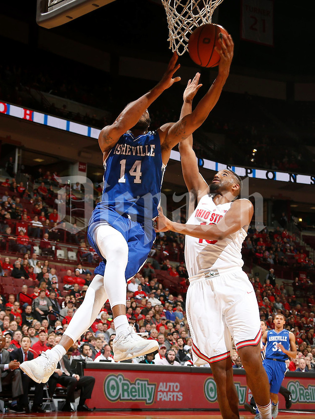 Ahmad Thomas (14) of the North Carolina-Asheville Bulldogs is guarded by JaQuan Lyle (13) of the Ohio State Buckeyes during Thursday's NCAA Division I basketball game at Value City Arena on December 22, 2016. (Barbara J. Perenic/The Columbus Dispatch)