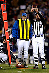 18 November 2007: NFL referee Bill Carollo indicates the results of a field measurement during a game between the New England Patriots and the Buffalo Bills at Ralph Wilson Stadium in Orchard Park, NY. The Patriots defeated the Bills 56-10 in their second meeting of the season...Mandatory Photo Credit: Ed Wolfstein Photo