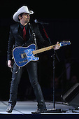 Country music recording artist Brad Paisley performs during the Commander-In-Chief Ball celebrating the inauguration of U.S. President Barack Obama at the Walter Washington Convention Center January 21, 2013 in Washington, DC. President Obama started his second term by taking the Oath of Office earlier in the day during a ceremony on the West Front of the U.S. Capitol. .Credit: Chip Somodevilla / Pool via CNP