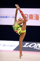 Evgenia Kanaeva of Russia holds balance with leg behind during clubs routine at 2006 Mie World Cup Finale of rhythmic gymnastics on November18, 2006.<br />