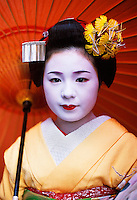 Komomo, a maiko with umbrella, Kyoto Japan.