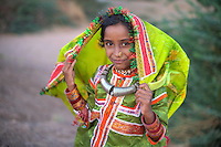 A girl, who is attending a local wedding, in the traditional costume of Harijans of Kutch.<br />