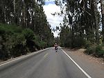 A dirt biker rides on a street in Cusco Peru