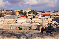 Rooftops in Old City of Jerusalem's Jewish Quarter, looking toward the Temple Mount and Dome of the Rock with the Mount of Olives and Augusta Victoria in the background.