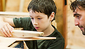 One of the kids with Will Redhead, woodwork teacher, Summerhill School, Leiston, Suffolk. The school was founded by A.S.Neill in 1921 and is run on democratic lines with each person, adult or child, having an equal say.  You don't have to go to lessons if you don't want to but could play all day.  It gets above average GCSE exam results.