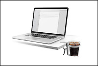 BNPS.co.uk (01202) 558833<br /> Picture: Vector/BNPS<br /> <br /> ***Please use full byline****<br /> <br /> A brand new cup holder has been invented to stop office workers spilling drinks on their keyboards.<br /> <br /> The special device looks like something that might be found in a car and clamps on to the side of a desk to hold a drink.<br /> <br /> The gadget can hold any size drinks from small plastic cups all the way up to a large takeaway container, pint glass, and a thermos.<br /> <br /> Because the centre of gravity of the beverage has been moved, it makes it almost impossible to knock over.<br /> <br /> The contraption, named the Vector Cupholder, was invented by Cliff Thier (52) after some of his friends broke their computers or burned themselves when spilling their drinks at work.