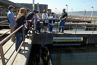 A tour group listens to the plant manager describe the treatment process at the Yonkers Sewage Treatment Plant in the city of Yonkers, NY in Westchester County on Saturday, April 25, 2009. (© Richard B. Levine)