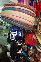 Mexican sombreros and masks in Mercado 28 souvenirs and handicrafts market in  Cancun, Mexico      .