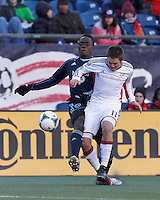 Sporting Kansas City defender Mechack Jerome (24) brings ball down the wing as New England Revolution defender Kelyn Rowe (11) defends.  In a Major League Soccer (MLS) match, Sporting Kansas City (blue) tied the New England Revolution (white), 0-0, at Gillette Stadium on March 23, 2013.