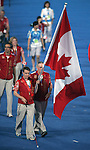 Donovan Tildesley (left) of Vancouver with his father Hugh lead the Canadian Paralympic team into the Bird's Nest Stadium during the opening ceremony of the Paralympic Games in Beijing, Friday, Sept., 5, 2008. Photo by Mike Ridewood/CPC