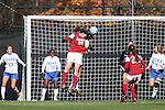 24 November 2013: Arkansas' Margaret Power (28) and Duke's Kim DeCesare (behind) challenge for a header. The University of Arkansas Razorbacks played the Duke University Blue Devils at Koskinen Stadium in Durham, NC in a 2013 NCAA Division I Women's Soccer Tournament Third Round match. Duke advanced by winning the penalty kick shootout 5-3 after the game ended in a 2-2 tie after overtime.