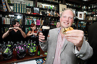 """26/7/2011. Porterhouse Celebrates Fifteen Years of Brewing with another Gold Medal. Pictured at the Sweny Chemist venue in Dublin celebrating is Peter Mosley Master Brewer with his medels.The Porterhouse Brewing Company is fifteen years old and to add to the celebrations they have been awarded a gold medal for their Plain Porter. The award, which is much sought after by brewers worldwide, was bestowed upon the Porterhouse's famous Plain Porter at the Brewing Industry International Awards, dubbed, """"The Brewing Oscars"""" in a glitzy ceremony at London's Guild Hall. It is the second time the Porterhouse has received this famous accolade. The first was in 1998 and again it was the Plain Porter that brought home the gold. The awards, with approximately eight hundred and fifty entries, are structured into nine categories with thirty-two classes and medals are extremely difficult to win. Picture Collins Photos"""