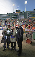 """Longtime Green Bay Packers photographer Vernon Biever poses with former Packers Willie Wood and Paul Hornung who served as Honorary Co-Captains of the NFC Championship game between the Packers and the Carolina Panthers at Lambeau Field on January 12, 1997. This was the first title game in Green Bay since the """"Ice Bowl"""" in 1967."""