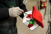 Rsgar Aziz, artigiano Kurdo iracheno, immigrato in Italia quasi 20 anni fa, mentre lavora nel suo laboratorio artigianale &ldquo;Casanova&rdquo; di maschere di cartapesta, Venezia.<br /> Rsgar Aziz, Kurdish Iraqi artisan, immigrant in Italy from 20 years, while working in his workshop &quot;Casanova&quot; of papier-m&acirc;ch&eacute; masks, Venice.