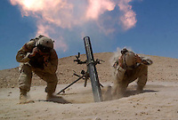 "A U.S. mortar team fires""harassment and interdiction fire"" outside the town of Rawah, Iraq. Thursday July 21, 2005"