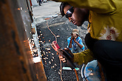 Indian labourers weld the metal wall of the parking lot of the main stadium for the approaching 19th Commonwealth Games 2010 in New Delhi, India.