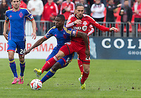 Toronto, Ontario - April 12, 2014: Colorado Rapids forward Edson Buddle #9 and Toronto FC midfielder Issey Nakajima-Farran #20 in action during the 1st half in a game between the Colorado Rapids and Toronto FC at BMO Field in Toronto.