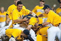 SANTA CLARA, CA--Cal Baseball players celebrate on the mound after a 6-2 win over Dallas Baptist University at Stephen Schott Stadium on the Santa Clara University campus in Santa Clara, CA. The win gives the Cal Bears a berth to the College World Series in Omaha, Nebraska. SUNDAY, JUNE 12, 2011.