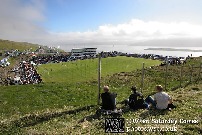 Faroe Islands 0 Scotland 2, 06/06/2007. European Championship Qualifier. Three Faroese fans watching the action from the hillside outside the ground as the Faroe Islands take on Scotland in a Euro 2008 group B qualifying match at the Svangaskard stadium in Toftir. The visitors won the match by 2 goals to nil to stay in contention for a place at the European football championships which were to be held in Switzerland and Austria in the Summer of 2008. It was the first time Scotland had won in the Faroes, the previous two matches ended in draws. Photo by Colin McPherson.