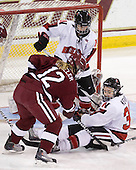 Alyssa Wohlfeiler (NU - 8), Ashley Wheeler (Harvard - 12), Kristi Kehoe (NU - 34) - The Harvard University Crimson defeated the Northeastern University Huskies 4-3 (SO) in the opening round of the Beanpot on Tuesday, February 8, 2011, at Conte Forum in Chestnut Hill, Massachusetts.