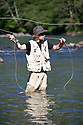 WA09146-00...WASHINGTON - Fly fishing on the Middle Fork of the Snoqualme River near North Bend. (MR# J9)