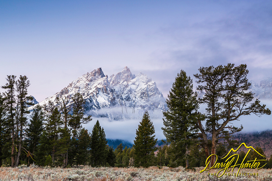 The Cathedral Group of peaks with a new frosting of autumn snow in Grand Teton National Park at sunrise.