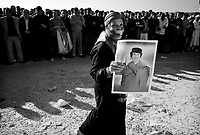 Tripoli, Libya, March 20, 2011.The Libyan Foreign Media department took foreign journalists to a funeral ceremony allegedly held for 25 victims of the first bombing day. However, after several hours, the the large crowd slowly dwelled away as no bodies ever arrived; at sunset only a few remained...