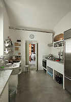 What was once a series of monastic cells has become an elegantly austere kitchen created in marble and concrete