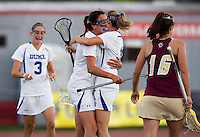 Kat Thomas (4) of Duke congratulates teammate (12) Amanda Jones on her goal during the first round of the ACC Women's Lacrosse Championship in College Park, MD.  Duke defeated Boston College, 17-6.