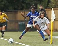 Duke University defender Natasha Anasi (4) earns a yellow card. Boston College forward Stephanie McCaffrey (9).Boston College (white) defeated Duke University (blue/white), 4-1, at Newton Campus Field, on October 6, 2013.