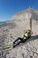 QT41724-D. woman enjoys a siesta between shore dives off the beach on Cabo Pulmo, Baja, Mexico, Sea of Cortez, Pacific Ocean.<br /> Photo Copyright &copy; Brandon Cole. All rights reserved worldwide.  www.brandoncole.com