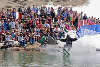 """Cushing Classic at Squaw Valley 14"" - Photograph of a skier crossing a pond during the Cushing Classic at Squaw Valley, USA."