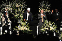 (L-r)Rabbi Michael Lerner raises his fist as Imam Zaid Shakir takes to the microphone, Rabbi Joe Rapport applauds and Dr. Kevin Cosby raises his fist at the memorial service for boxing legend Muhammad Ali at the KFC Yum! Center in Louisville, Kentucky on June 10, 2016.  Ali was involved in the planning of the ceremony which included speeches from leaders of numerous faith as well as comedian Billy Crystal and former American President Bill Clinton.