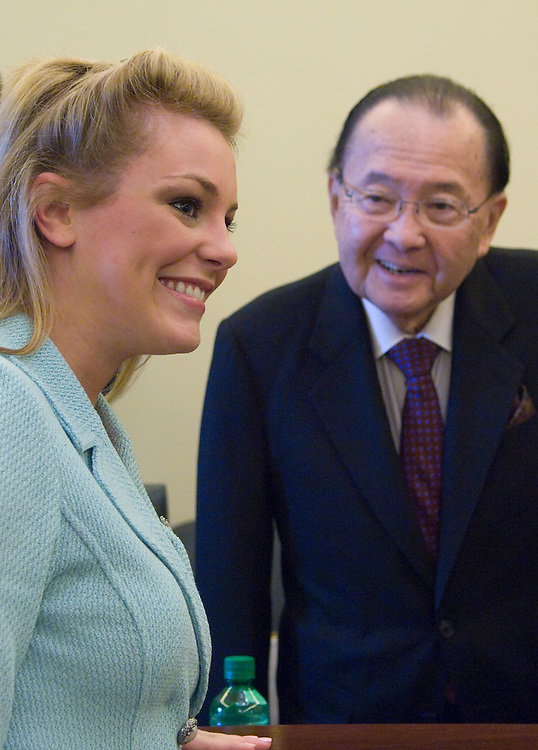 """Chairman Daniel Inouye, D-HI., greets Miss America 2007 Lauren Nelson before the start of the Senate Commerce, Science and Transportation Committee Child Internet Protection full committee hearing on """"Protecting Children on the Internet.."""
