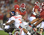 Alabama running back Trent Richardson (3) is tackled  y Ole Miss linebacker Allen Walker (9) at Bryant-Denny Stadium in Tuscaloosa, Ala.  on Saturday, October 16, 2010. Alabama won 23-10.