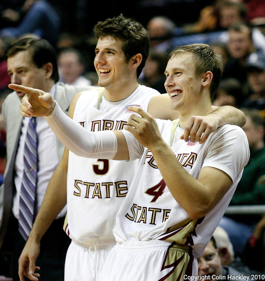 TALLAHASSEE, FL 2/14/10-FSU-BC BB10 CH30-Florida State's Deividas Dulkys, right, and Luke Loucks react at the close of the Boston College game Sunday at the Donald L. Tucker Center in Tallahassee. The Seminoles beat the Eagles 62-47...COLIN HACKLEY PHOTO