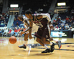 "Arkansas Little Rock's Leroy Isler (13) comes up with the ball in front of Mississippi's Murphy Holloway (31) at the C.M. ""Tad"" Smith Coliseum in Oxford, Miss. on Friday, November 16, 2012."