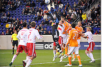 New York Red Bulls goalkeeper Bouna Coundoul (18) goes up for a ball. The New York Red Bulls  and the Houston Dynamo played to a 1-1 tie during a Major League Soccer (MLS) match at Red Bull Arena in Harrison, NJ, on April 02, 2011.