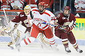 Sean Escobedo (BU - 21), Cam Atkinson (BC - 13) - The visiting Boston College Eagles defeated the Boston University Terriers 3-2 to sweep their Hockey East series on Friday, January 21, 2011, at Agganis Arena in Boston, Massachusetts.