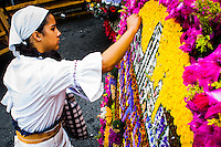 A woman ends her floral arrangement to take part on the 58th Silleteros' parade in the framework of the flowers' fair, this year the silleteros' parade was declared intangible heritage of Colombia. Medellín, Colombia 09/08/2015
