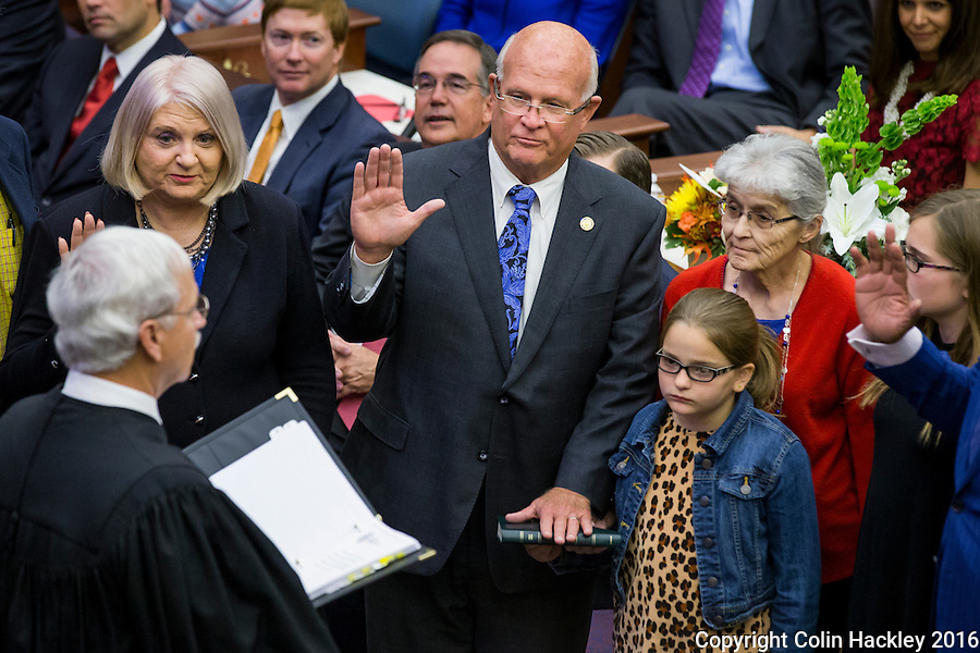 TALLAHASSEE, FLA. 11/22/16-Florida Supreme Court Justice Ricky Polston, left, administers the oath of office to Sen. Linda Stewart, D-Orlando,  and Sen. Dennis Baxley, R-Ocala, during the 2016 organizational session at the Capitol in Tallahassee.<br /> <br /> COLIN HACKLEY PHOTO