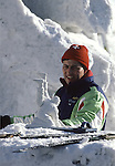 A snow sculpture team member from the Switzerland looks over a model of two wrestlers. Using ice picks, chisels and hatchets, teams from around the world,  turn blocks of frozen snow into detailed scupltures. These are not traditional Frosty the Snowmen, but huge carved and chiseled Samurai Warriors, Buddhists gods, historical heroes of fairy tales and Walt Disney characters. Some stand as big as buildings. Chiseled out of tons of packed snow, the sculptures are the pride and job of the residents of Sapporo, Japan, who hosts the world famous Ice and Snow Sculpture Festival for five days in early February.Themes of the sculptures are picked from Kabuki stages, historical characters or fairy tales. (Jim Bryant Photo).....