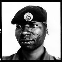 """Kambale Buyori, park-keeper: 'I have been a park-keeper in the Virunga nature park for six years. Before that, I was a private soldier for 13 years. I often ended up in fire fights. Shooting on all sides, from hilltop to hilltop. I wasn't afraid, that's part of the game. But I still don't like seeing corpses. As a park-keeper I have to arrest smugglers in the illegal charcoal trade and protect the silverback gorillas against the rebels and poachers. I consider that an honour, because I am moved by the beauty and power of the rare mountain gorilla. Because there are only 700 mountain gorillas left in the world, 150 of them here in the Virunga Park. With such a small population, you realise how important just one gorilla life is. We often come into contact with them in the hills. I once patted the knee of the goriall leader, Mukoya. Mukoya means """"he that comes closer"""". Believe me, when you sit next to such an imposing animal it's a privilege to risk your life to preserve such a rare and fine species as the silverback.'.."""