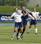 19 June 2004: Aly Wagner (10) and Angela Hucles (19). The Washington Freedom tied the Boston Breakers 3-3 at the National Sports Center in Blaine, MN in Womens United Soccer Association soccer game featuring guest players from other teams.
