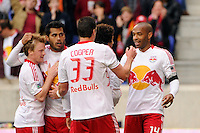 Kenny Cooper (33) of the New York Red Bulls celebrates scoring with teammates  during the second half against the Colorado Rapids. The New York Red Bulls defeated the Colorado Rapids 4-1 during a Major League Soccer (MLS) match at Red Bull Arena in Harrison, NJ, on March 25, 2012.