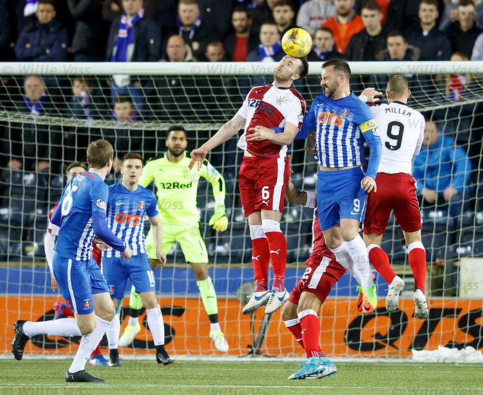 Danny Wilson clears from Kris Boyd