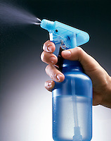 TRANSPARENT PUMP SPRAY BOTTLE - In Use (2 of 2)<br /> A reciprocating piston pump pressurizes the water in a spray bottle, expelling it from the nozzle.