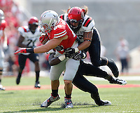 Ohio State Buckeyes tight end Jeff Heuerman (86) gets pulled down by San Diego State Aztecs fullback Connor Keith (42)   During the NCAA football game at Ohio Stadium in Columbus, Ohio on Sept. 7, 2013. (Columbus Dispatch photo by Kyle Robertson)