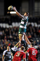 Ed Slater of Leicester Tigers rises high to win lineout ball. European Rugby Champions Cup match, between Leicester Tigers and Munster Rugby on December 20, 2015 at Welford Road in Leicester, England. Photo by: Patrick Khachfe / JMP